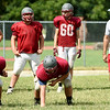Nevada Head Coach Wes Beachler works with his linemen during practice on Wednesday at NHS.<br /> Globe | Laurie Sisk