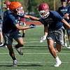 Joplin receiver Zach Westmoreland, right,  tries to get past defensive back James Moman during the first day of football practice on Monday morning at JHS.<br /> Globe | Laurie Sisk