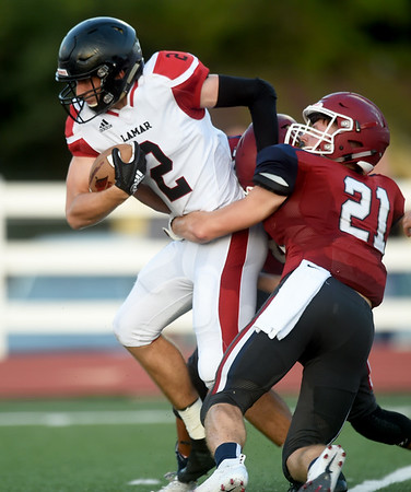 Lamar's JD Bishop tries to get past Joplin's Nic Lewis (21) during their scrimmage on Friday night at Junge Stadium.<br /> Globe | Laurie SIsk