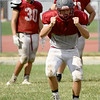 Nevada's Ethan Couch works on blocking drills during practice on Wednesday at NHS.<br /> Globe | Laurie Sisk