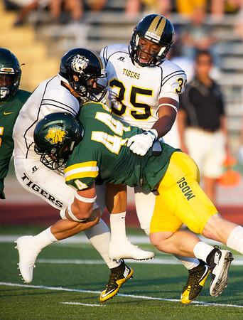 Missouri Southern linebacker Roc Robbins (44) brings down Fort Hays State's Layne Bierberle (9) as Jeron Caraway looks on during their season opener on Thursday night at Fred G. Hughes Stadium. <br /> Globe | Laurie Sisk(35)