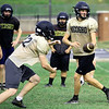Neosho quarterback Gage Kelley hands off to runningback Cade Lyerla during practice on Friday at NHS.<br /> Globe   Laurie Sisk