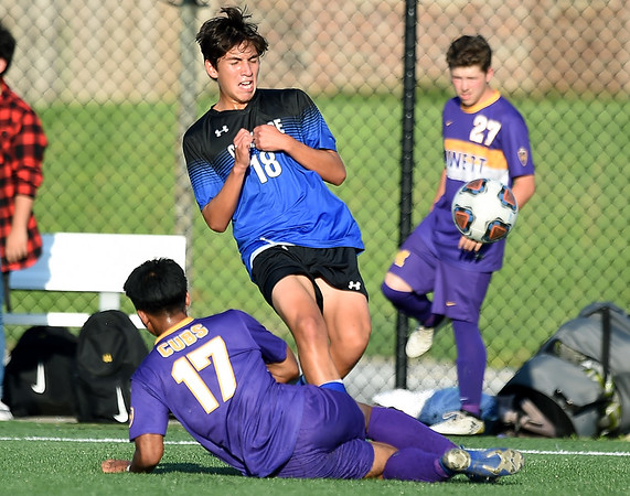 Carthage's Jesus Alvarado (18) clears the ball as Monett's Misael Vila (17) defends during their scrimmage at the Joplin Jamboree on Tuesday night at Joplin High School.<br /> Globe   Laurie Sisk
