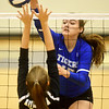 Carthage's A. Crockfrod gets a spike past an Aurora defender during the Carthage Volleyball Jamboree on Tuesday night at Carthage High School.<br /> Globe | Laurie Sisk