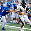 Jay's Bulldogs Daylon Simpson (7) runs the ball near the side lines as he gets push by Issac Lacy (3) of the Miami's Wardogs on Friday evening at the Red Robertson Field in Miami Ok<br /> Globe|Israel Perez