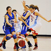 Globe/T. Rob Brown<br /> Webb City's Mikaela Burgess (15) blocks a pass with her foot while playing defense against Carthage's Leigh Ann Craig (23) during Saturday afternoon's championship game, Dec. 1, 2012, at Carl Junction High School's gymnasium.
