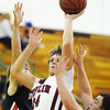Globe/T. Rob Brown<br /> Joplin's Daniel Stokes shoots over McDonald County defenders Monday night, Dec. 10, 2012, at MSSU's Young Gymnasium. McDonald County's Pablo Alvarez, left, and Josh Serr, right.