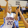 Globe/T. Rob Brown<br /> Webb City's Megan Heman shoots over Carthage's Chloé Shepherd during Saturday afternoon's championship game, Dec. 1, 2012, at Carl Junction High School's gymnasium.