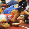 Globe/Roger Nomer<br /> Carthage's Ervin Cancinos, top, wrestles Webb City's Jason Bailey during the 113-pound match at Carl Junction on Saturday.  Cancinos won the match on points.