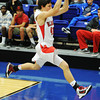 Globe/T. Rob Brown<br /> Carl Junction's Ryan Devore barely keeps a ball from going out of bounds during Saturday afternoon's championship game against Joplin, Dec. 1, 2012, at Carthage High School's gymnasium.