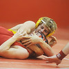 Globe/Roger Nomer<br /> Monett's Kedrick Brink pins Labette County's Michael Parker in the 126-pound match at Carl Junction on Saturday.