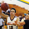 Globe/T. Rob Brown<br /> McDonald County's Josh Serr fouls Joplin's Chase Hall under the basket Monday night, Dec. 10, 2012, at MSSU's Young Gymnasium.
