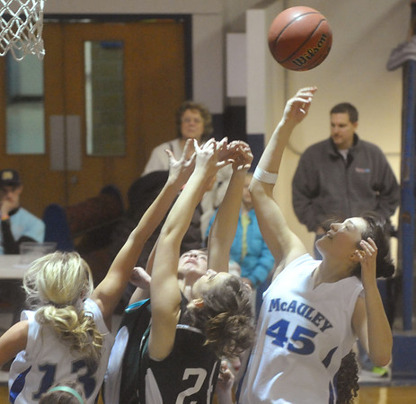 Globe/Roger Nomer<br /> McAuley's Victoria Foley tips out a rebound during Wednesday's game.