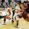 Globe/T. Rob Brown<br /> Carl Junction's Matt Magee drives the ball as teammate Ryan Devore follows behind and Joplin's Keondre Adams plays defense during Saturday afternoon's championship game, Dec. 1, 2012, at Carthage High School's gymnasium.