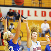 Globe/T. Rob Brown<br /> Webb City's Desirea Buerge shoots over Carthage's Chloé Shepherd under the basket during Saturday afternoon's championship game, Dec. 1, 2012, at Carl Junction High School's gymnasium.