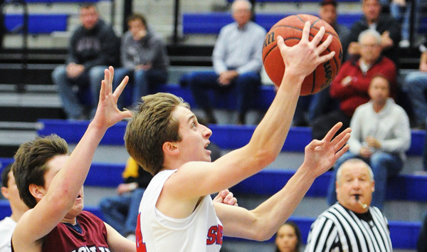 Seneca's Seth Harris goes up for a shot ahead of Joplin's Austin Zengel during Saturday afternoon's game, Dec. 21, 2013, during the Sixth Annual Carthage Invitational at Carthage High School's gymnasium.<br /> Globe | T. Rob Brown