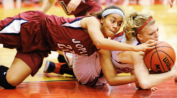 Joplin's Bailey Taylor competes with Seneca's Elena Wood for a loose ball Thursday night, Dec. 19, 2013, at Seneca High School's gymnasium.<br /> Globe | T. Rob Brown