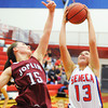 Seneca's Bailey Skelton brings down the rebound ahead of Joplin's Kelsey Johnson Thursday night, Dec. 19, 2013, at Seneca High School's gymnasium.<br /> Globe | T. Rob Brown