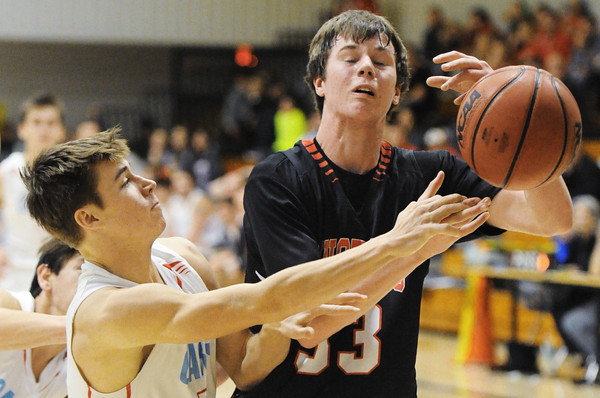 Webb City's Tyson Roderique knocks a rebound away from McDonald County's Daton Aubrey during the 59th Annual Neosho Holiday Classic game Thursday night, Dec. 26, 2013, at Neosho Middle School.<br /> Globe | T. Rob Brown