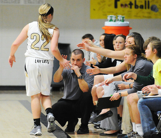 Neosho's Addi Long is congratulated by coach Lance Robbins and the rest of the Lady Cats bench during Friday evening's game, Dec. 27, 2013, against Carthage during the 59th Annual Neosho Holiday Classic at Neosho Middle School's gymnasium.<br /> Globe | T. Rob Brown