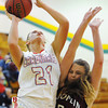 Webb City's Desirea Buerge shoots for two under the basket as Joplin's Danielle Hollingshead plays defense Thursday night, Dec. 12, 2013, during the 17th Annual Freeman Lady Eagle Classic basketball tournament at MSSU's Robert Ellis Young Gymnasium.<br /> Globe | T. Rob Brown