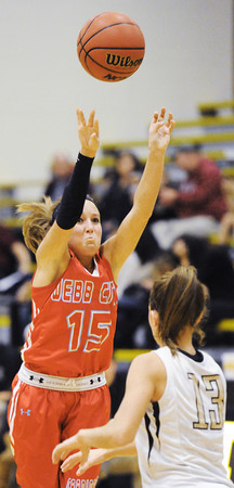 Webb City's Mikaela Burgess shoots a three over Bentonville's Jordan Martin during Saturday evening's game, Dec. 28, 2013, during the 59th Annual Neosho Holiday Classic at Neosho High School's gymnasium.<br /> Globe | T. Rob Brown