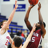 Joplin's Charlie Brown attempts a shot as Seneca defenders including Elias Roelfsema (21) put on the pressure during Saturday afternoon's game, Dec. 21, 2013, during the Sixth Annual Carthage Invitational at Carthage High School's gymnasium.<br /> Globe | T. Rob Brown