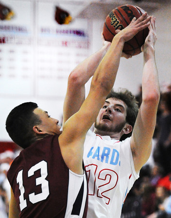 Joplin's Carlos Santillan pressures Webb City shooter Zach Hallacy during Friday night's game, Dec. 20, 2013, at Webb City's gymnasium.<br /> Globe | T. Rob Brown