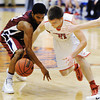 Seneca's Elias Roelfsema and Joplin's Keiondre Adams compete for a loose ball during Saturday afternoon's game, Dec. 21, 2013, during the Sixth Annual Carthage Invitational at Carthage High School's gymnasium.<br /> Globe | T. Rob Brown