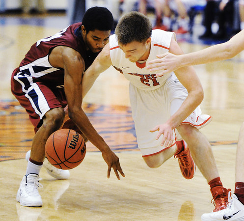 Seneca's Elias Roelfsema and Joplin's Keiondre Adams compete for a loose ball during Saturday afternoon's game, Dec. 21, 2013, during the Sixth Annual Carthage Invitational at Carthage High School's gymnasium.<br /> Globe   T. Rob Brown