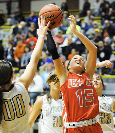 Webb City's Mikaela Burgess goes up for a shot over Bentonville's Heather Bowen during Saturday evening's game, Dec. 28, 2013, during the 59th Annual Neosho Holiday Classic at Neosho High School's gymnasium.<br /> Globe | T. Rob Brown