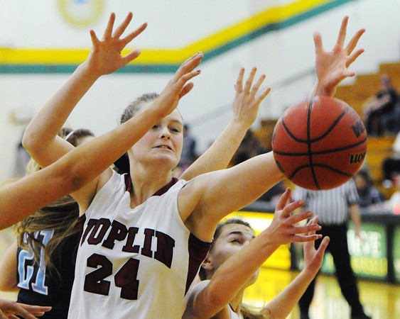 Joplin's Danielle Hollingshead reaches for a rebound against Har-Ber players Friday night, Dec. 13, 2013, during the 17th Annual Freeman Lady Eagle Classic at Missouri Southern State University's Robert Ellis Young Gymnasium.<br /> Globe | T. Rob Brown
