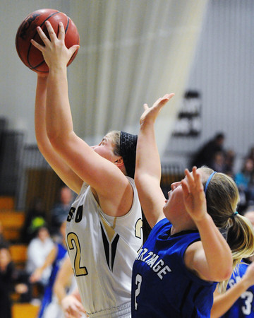 Neosho's Addi Long brings down a rebound ahead of Carthage's Regan Gartner Friday evening, Dec. 27, 2013, during the 59th Annual Neosho Holiday Classic at Neosho Middle School's gymnasium.<br /> Globe | T. Rob Brown