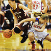 Joplin's Marissa Queen competes with Seneca's Willow Rhoades for a loose ball Thursday night, Dec. 19, 2013, at Seneca High School's gymnasium.<br /> Globe | T. Rob Brown