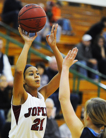 Joplin's Bailey Taylor passes the ball over Har-Ber's Evie Cannon Friday night, Dec. 13, 2013, during the 17th Annual Freeman Lady Eagle Classic at Missouri Southern State University's Robert Ellis Young Gymnasium.<br /> Globe | T. Rob Brown