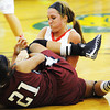 Webb City's Mikaela Burgess (above) and Joplin's Bailey Taylor fight for control of a loose ball Thursday night, Dec. 12, 2013, during the 17th Annual Freeman Lady Eagle Classic basketball tournament at MSSU's Robert Ellis Young Gymnasium.<br /> Globe | T. Rob Brown