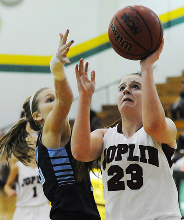 Joplin's Katie Sticklen shoots for two under the basket past a Har-ber defender Friday night, Dec. 13, 2013, during the 17th Annual Freeman Lady Eagle Classic at Missouri Southern State University's Robert Ellis Young Gymnasium.<br /> Globe | T. Rob Brown