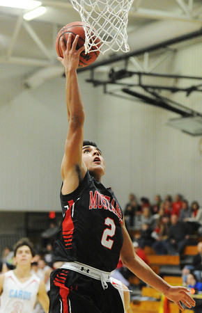 McDonald County's Damian Monsalvo scores on a breakaway against Webb City during the 59th Annual Neosho Holiday Classic game Thursday night, Dec. 26, 2013, at Neosho Middle School.<br /> Globe | T. Rob Brown