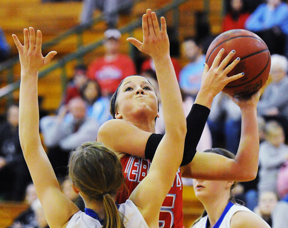 Webb City's Mikaela Burgess goes up for two over Marshfield's Lilia Theobald during Saturday night's championship game, Dec. 14, 2013, of the 17th Annual Freeman Lady Eagle Classic hosted by Joplin High School at MSSU's Robert Ellis Young Gymnasium.<br /> Globe | T. Rob Brown