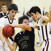Joplin's Dillon McVay (left) and Jace Braker (right) surround Lebanon's Connor Hicks with defense Monday night, Dec. 16, 2013, at MSSU's Robert Ellis Young Gymnasium.<br /> Globe | T. Rob Brown