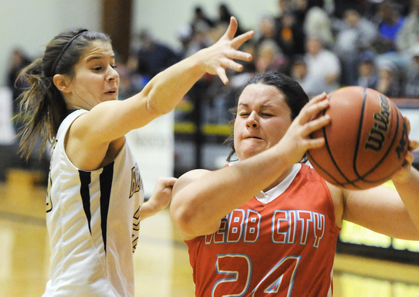 Webb City's Kaitlin Beason attempts to get past Bentonville's Kindal Coleman during Saturday evening's game, Dec. 28, 2013, during the 59th Annual Neosho Holiday Classic at Neosho High School's gymnasium.<br /> Globe | T. Rob Brown