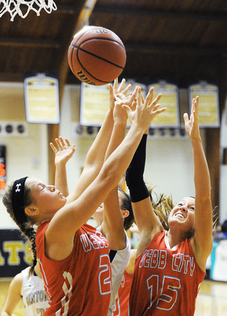 Webb City's Desirea Buerge (21) and Mikaela Burgess (15) work for a rebound against Bentonville during Saturday evening's game, Dec. 28, 2013, during the 59th Annual Neosho Holiday Classic at Neosho High School's gymnasium.<br /> Globe | T. Rob Brown