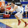 Seneca's Elias Roelfsema prevents a ball from going out of bounds while playing against Joplin during Saturday afternoon's game, Dec. 21, 2013, during the Sixth Annual Carthage Invitational at Carthage High School's gymnasium.<br /> Globe | T. Rob Brown