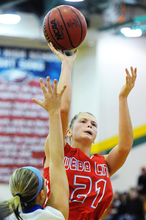 Webb City's Desirea Buerge shoots over Marshfield's Allie Owens during Saturday night's championship game, Dec. 14, 2013, of the 17th Annual Freeman Lady Eagle Classic hosted by Joplin High School at MSSU's Robert Ellis Young Gymnasium.<br /> Globe | T. Rob Brown