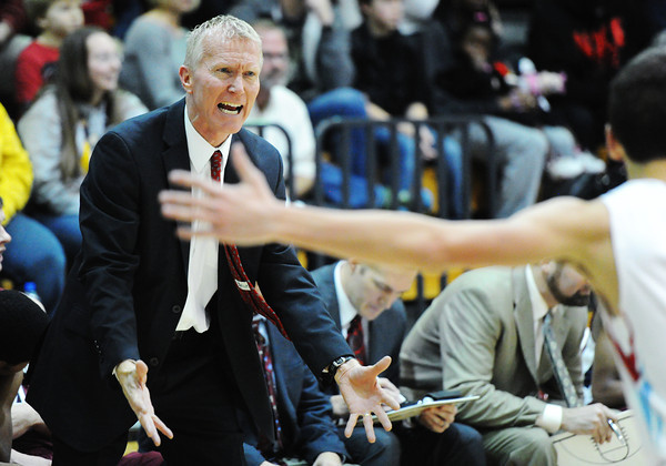 Joplin coach Jeff Williams gives orders from the sideline as Joplin faces Webb City during Friday night's game, Dec. 20, 2013, at Webb City's gymnasium.<br /> Globe | T. Rob Brown