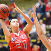 Webb City's Desirea Buerge goes up for a shot over a Bentonville defender during Saturday evening's game, Dec. 28, 2013, during the 59th Annual Neosho Holiday Classic at Neosho High School's gymnasium.<br /> Globe | T. Rob Brown