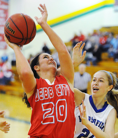 Webb City's Megan Heman shoots over Marshfield's Leah Flower during Saturday night's championship game, Dec. 14, 2013, of the 17th Annual Freeman Lady Eagle Classic hosted by Joplin High School at MSSU's Robert Ellis Young Gymnasium.<br /> Globe | T. Rob Brown