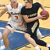 Neosho's Brady Wise (2) drives the lane as McDonald County's Peyton Barton (3) defends during their consolation semifinal game in the Carthage Invitational on Friday night at Carthage.<br /> Globe | Laurie SIsk