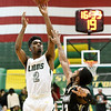 Missouri Southern's Koray Gilbert (2) scores over Lindenwood's Brad Newman (12) during their game on Saturday at Leggett & Platt.<br /> Globe | Laurie Sisk