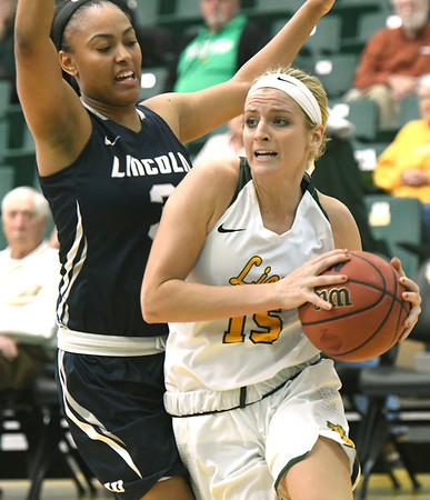 Missouri Southern's Chelsey Henry (15) drives past Lincoln's Lajanea Kimbrough (3) during their game on Thursday night at Leggett & Platt.<br /> Globe | Laurie Sisk
